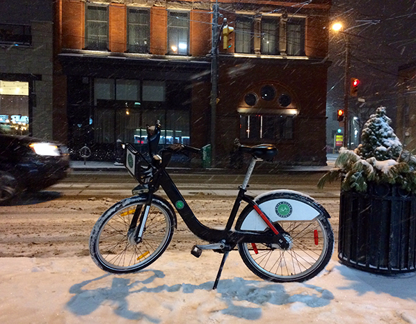 Bike Share bike parked on a snowy evening