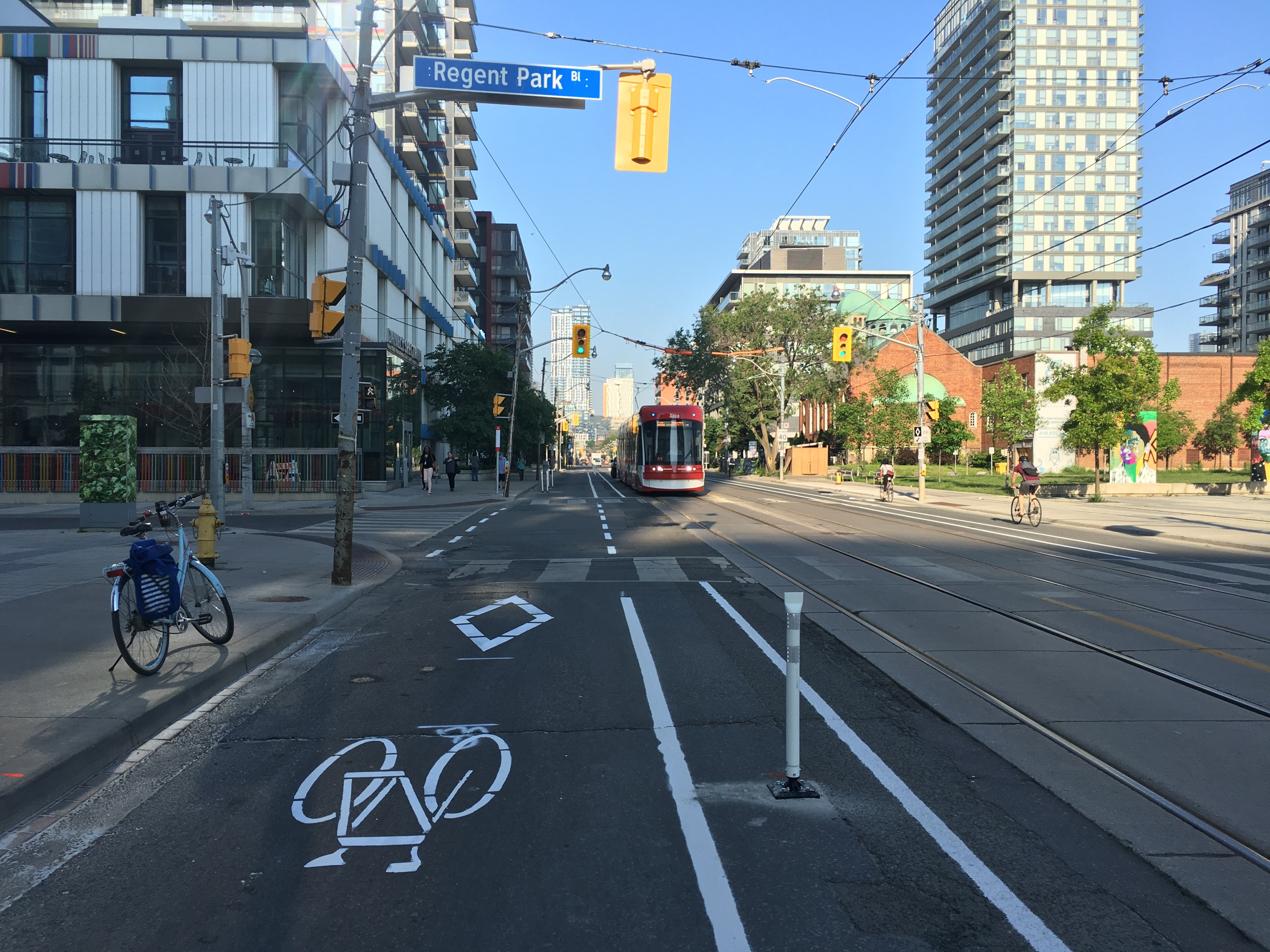 Bike lane with bollards takes has been freshly installed