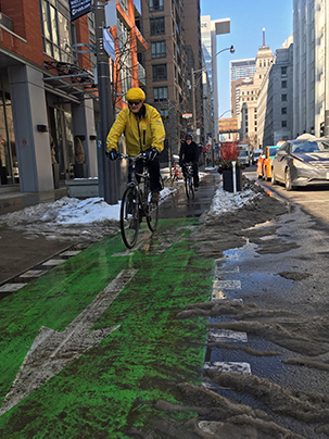 Cycling on the Simcoe St protected bike lanes