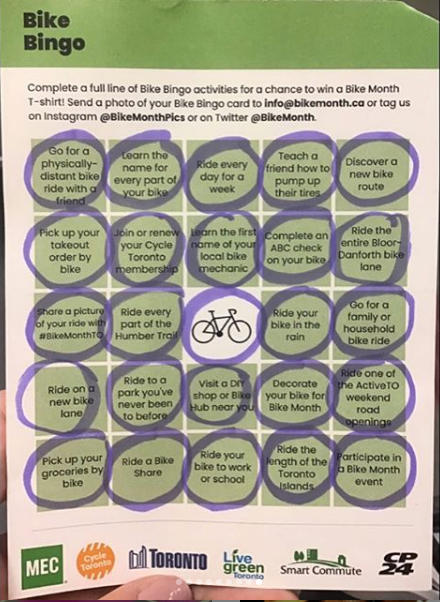 A bingo card with biking activities is completely filled out.