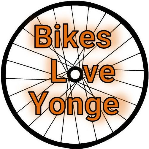 Bikes love Yonge is written over the top of a bicycle wheel