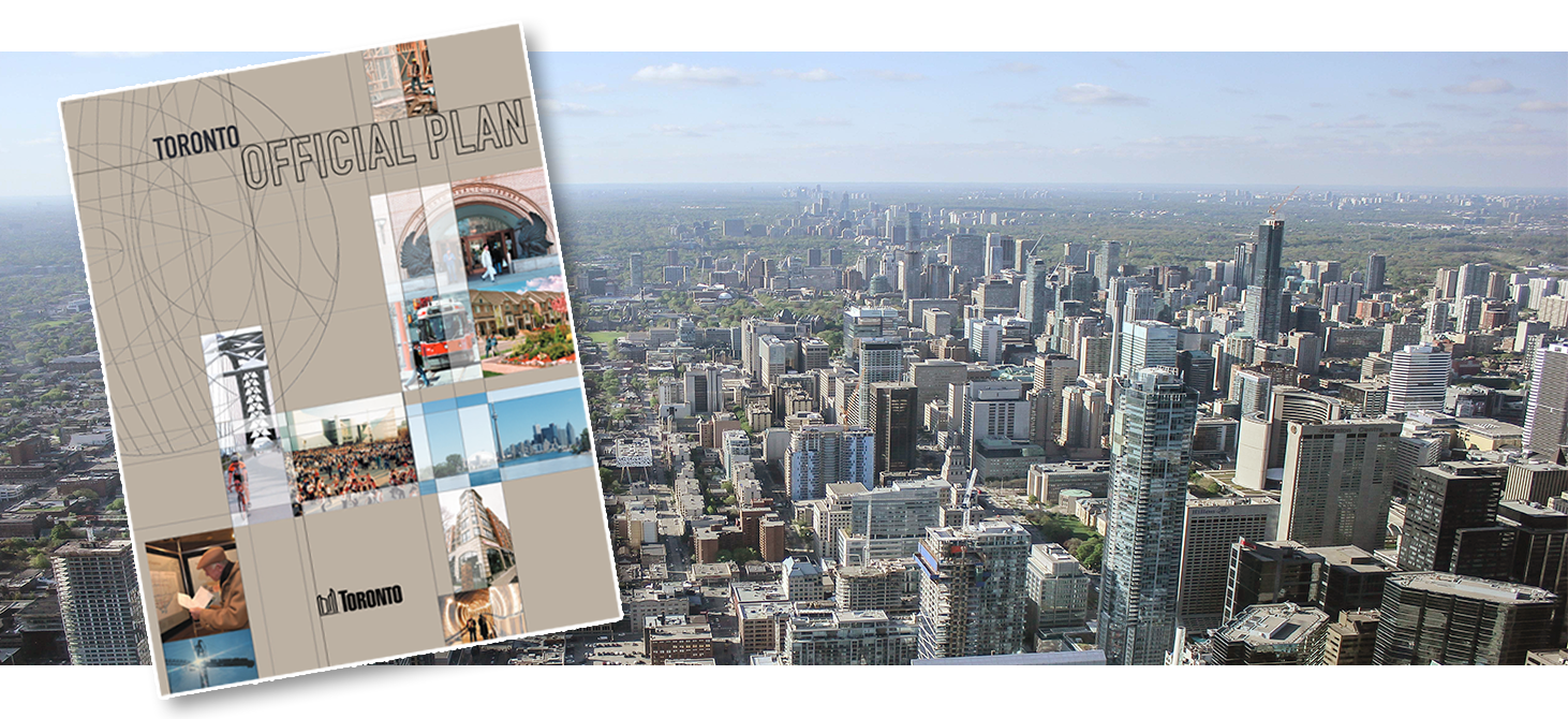 Toronto Official Plan book over a view of the city