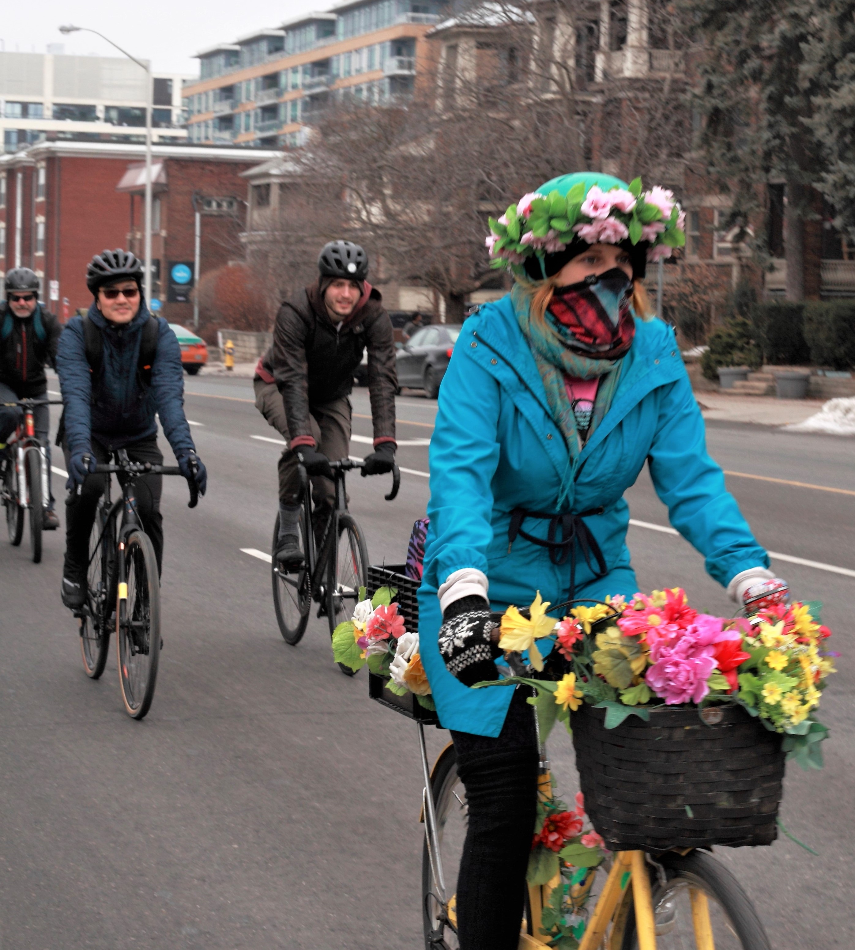 Rider with flowers on their bike
