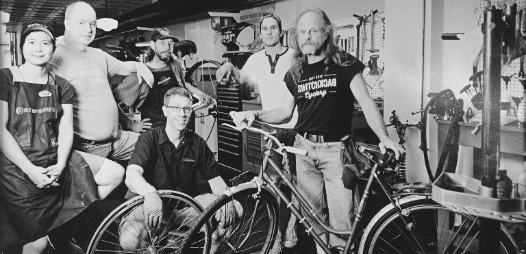 Black and white photo of the team at Switchback Cyclery