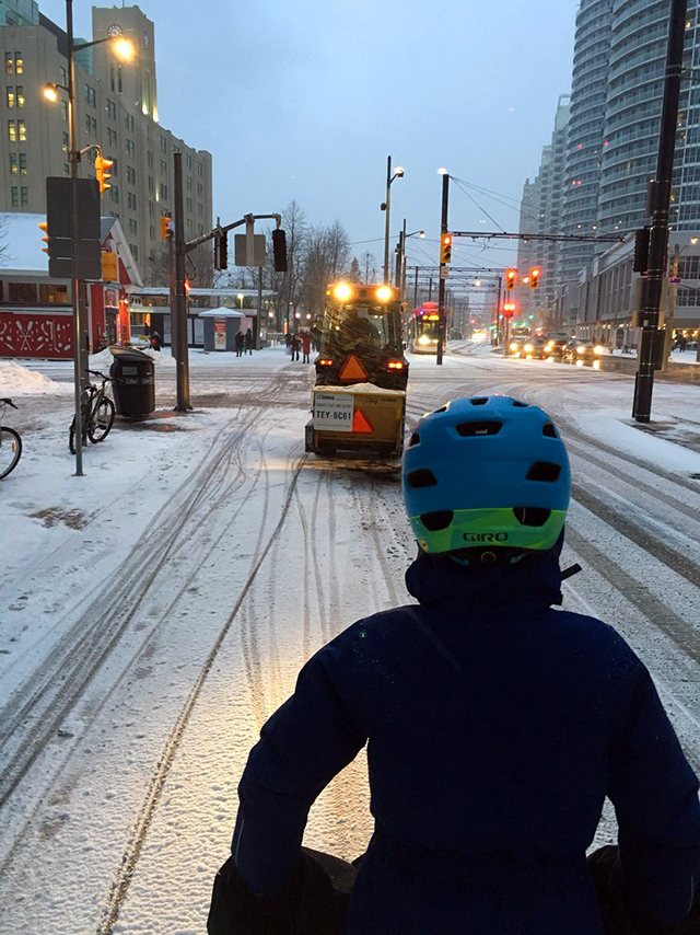 Cyclist rides on the Martin Goodman trail in light snow