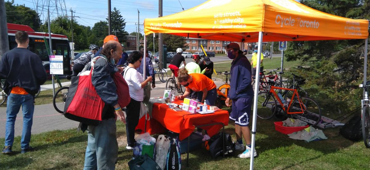 People queue up at a Cycle Toronto tent