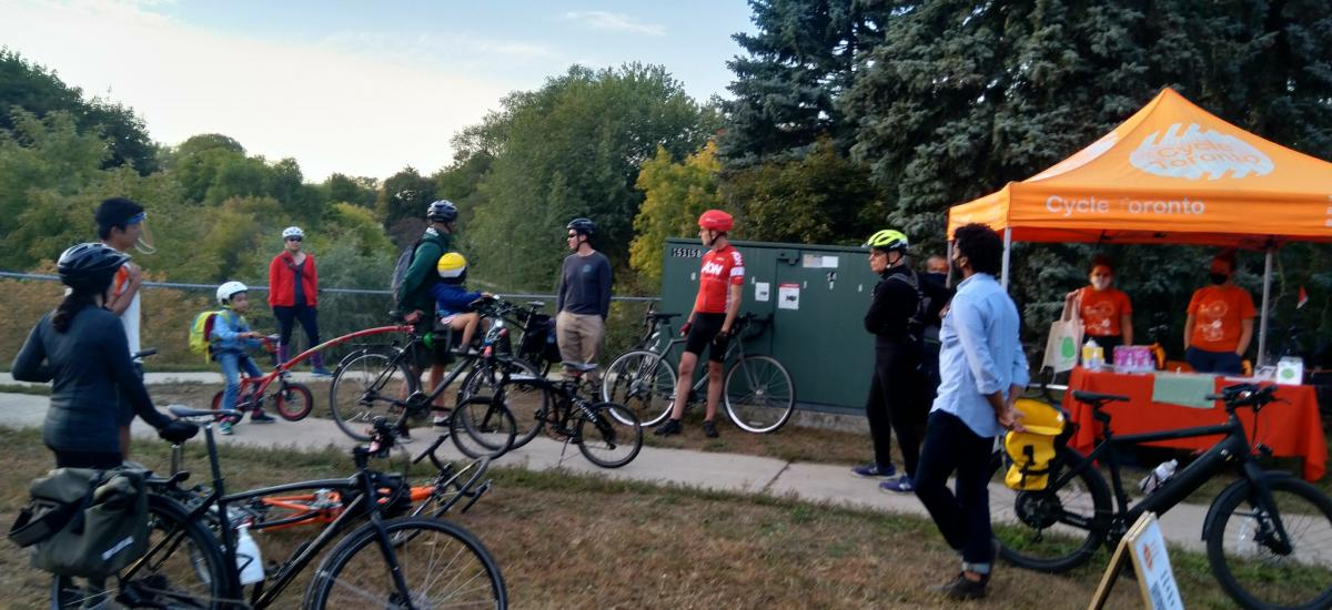 People on bikes meet up for a ride