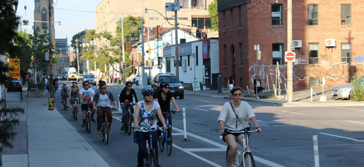 people riding on Adelaide St.