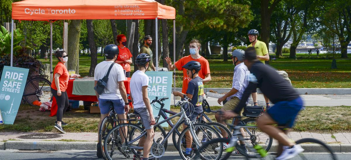 Youth on bikes queue up at a Cycle Toronto tent