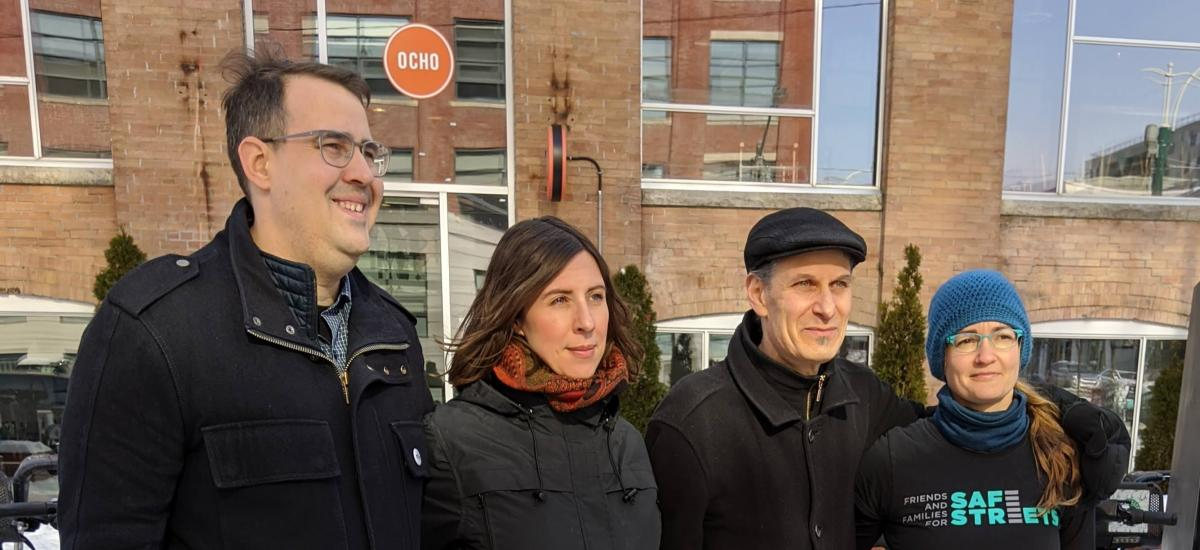 Road safety advocates pose in the cold