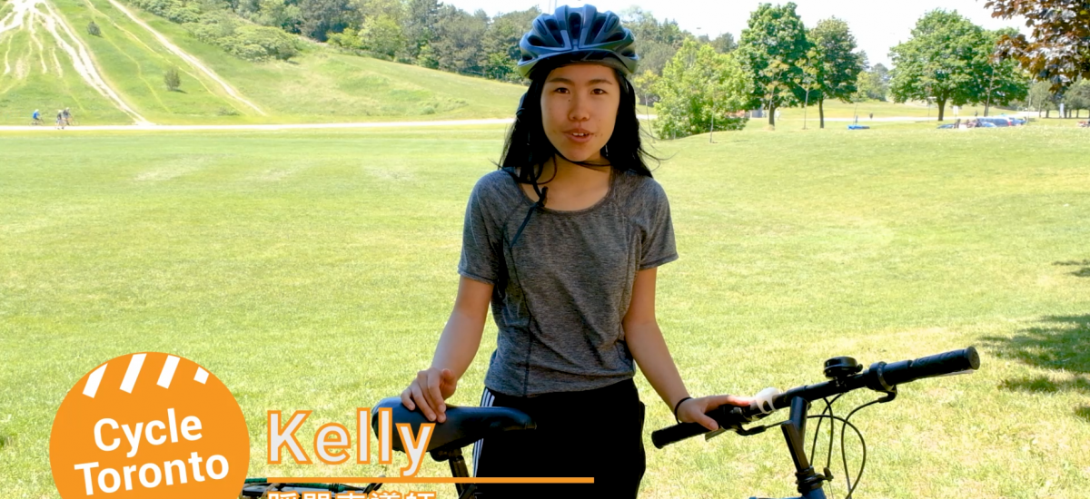 Person standing with a bike in a field