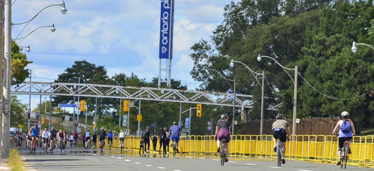 Lake Shore Boulevard West at Ontario Place is open with many people riding bikes on it.
