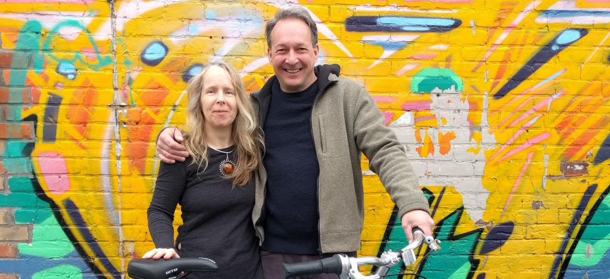 Lorraine and Travis with Travis' new bike outside Urbane Cyclist