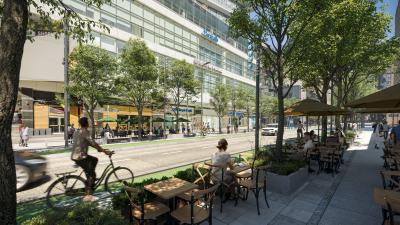A realistic rendering of Yonge street shows a vibrant patio scene. People ride bikes in a protected bike lane amidst lush trees.