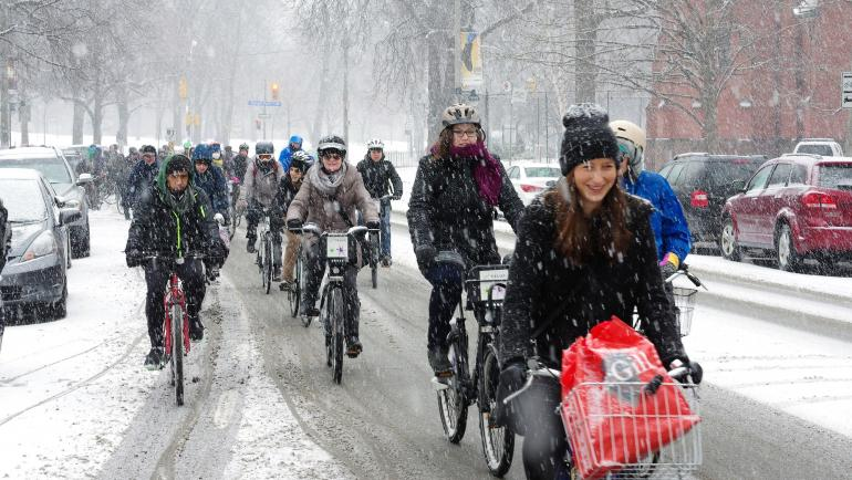 People riding bikes in snow