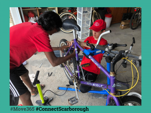 Two youths fixing their bike