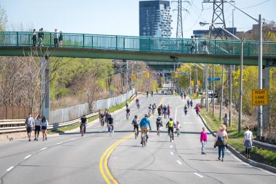 People walk and cycle on Bayview St