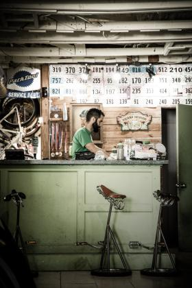 man behind repair desk at a bike shop