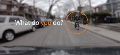 road rules video capture showing woman riding a bike