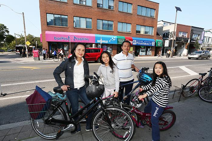Family with bikes on Bloor St