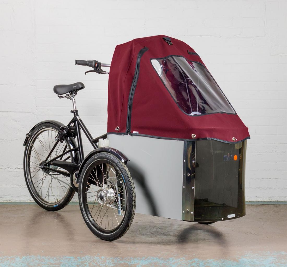 E assists cargo tricycle with covered storage area in front