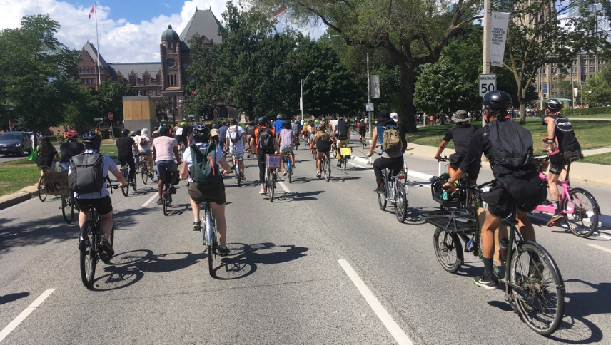 Many people ride bikes beside Queen's Park.