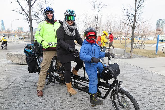 Derek and his family on a cargo bike in the winter
