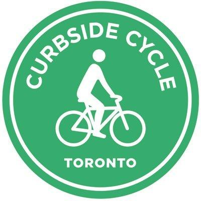 Green circle with a white outline of a person biking inside