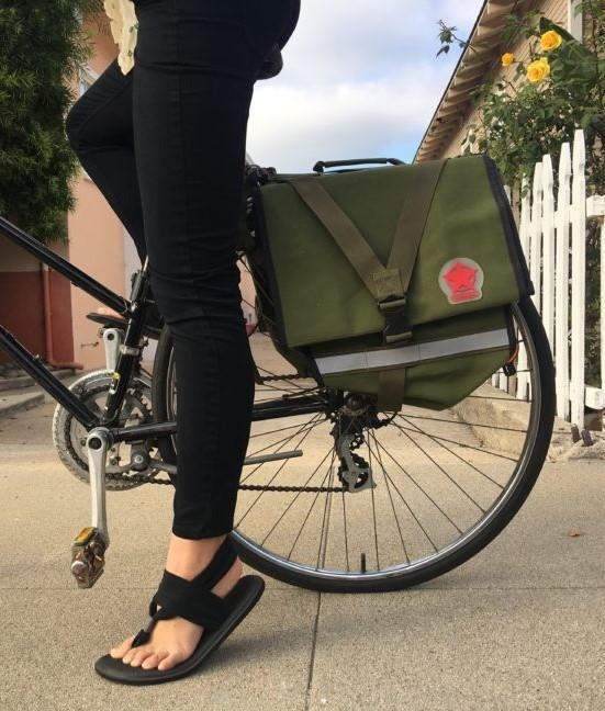 Person on a bike with a neutral tone pannier